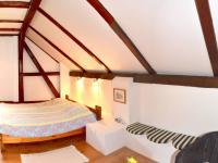 ložnice v 1NP (Prodej domu v osobním vlastnictví 200 m², Líšnice)