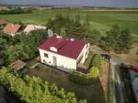 Pohled na pozemek (Prodej domu v osobním vlastnictví 380 m², Slatinice)