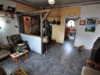 Přízemí - obývací část a vstup do kuchyně (Prodej domu v osobním vlastnictví 140 m², Třebenice)