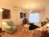 1. patro - pánská ložnice (Prodej domu v osobním vlastnictví 776 m², Líšnice)