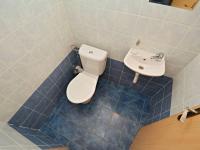 Samostatné WC v 1. obytném patře (Prodej bytu 3+kk v osobním vlastnictví 83 m², Praha 9 - Letňany)