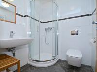 Koupelna. - Prodej bytu 1+kk v osobním vlastnictví 37 m², Praha 5 - Smíchov