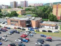 Parkoviště, zadní část OC Elda - Pronájem obchodních prostor 34 m², Most