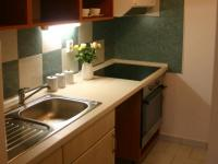 v kuchyni je prostor i pro myčku - Prodej bytu 2+kk v osobním vlastnictví 44 m², Praha 10 - Horní Měcholupy