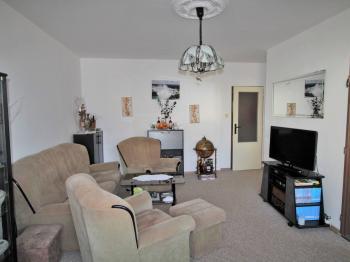 Obývací pokoj - Prodej bytu 3+1 v družstevním vlastnictví 71 m², Praha 8 - Čimice