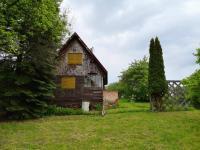 Dřevěná chata zezadu - Prodej pozemku 2173 m², Bílovice nad Svitavou