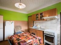 Kuchyň v přízemí (Prodej domu v osobním vlastnictví 98 m², Praha 10 - Hostivař)