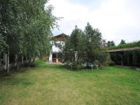 pohled na dům z pozemku (Prodej domu v osobním vlastnictví 300 m², Řitka)